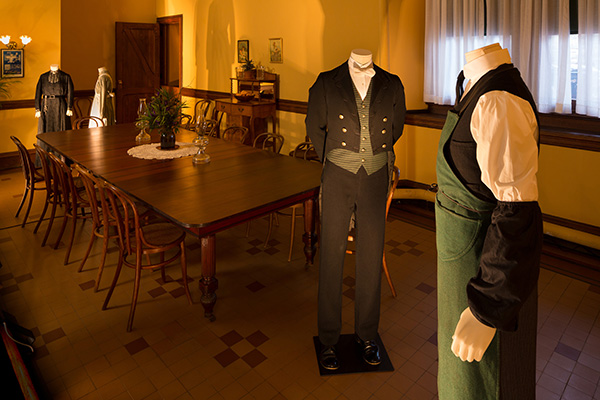 A footman (left) and valet (right) stand in the servants' dining room. Photo Credit: The Biltmore Company