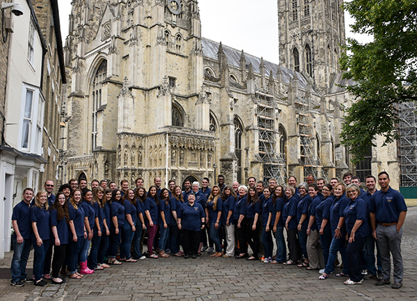 The Chamber Singers pose for a photograph outside Canterbury Cathedral.