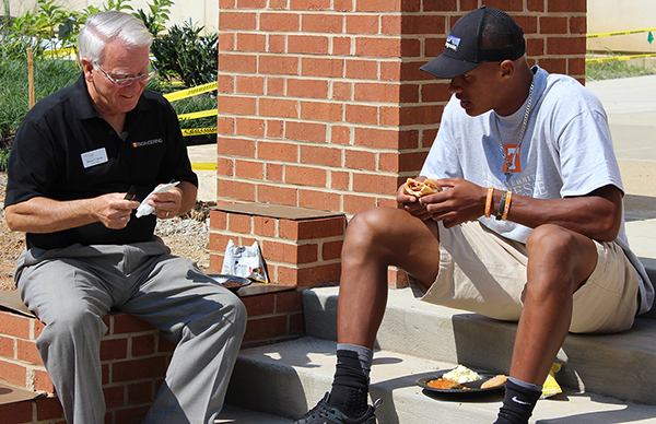College of Engineering Dean Wayne Davis, left, talks with aerospace engineering student and UT quarterback Joshua Dobbs during a recent welcome-back barbecue.