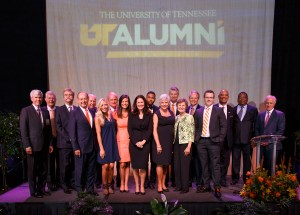 """Group photo of all the award winners during The University of Tennessee 2015 Alumni Board Awards Dinner at the Knoxville Convention Center on October 2, 2015 (l-r): Kim C. Bush, Nathan Sam Dougherty, C. Keith Boswell, Chancellor Jimmy G. Cheek, Howard E. Chambers, Ellie Holcomb, Terry Begley, Rachel Cruze, Amy Miles, Inky Johnson, Carol V. Aebersold, Richard L. Rose, Ann Holt Skadberg, Alan D. Wilson, Robert Bellenfant, Dwight """"Book"""" Hutchins, Mike Littlejohn, and Senator Bob Corker. (Credit Image: Steven Bridges - http://knoxphotog.com)"""