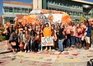 Students greet Noah Hays at the Rock.