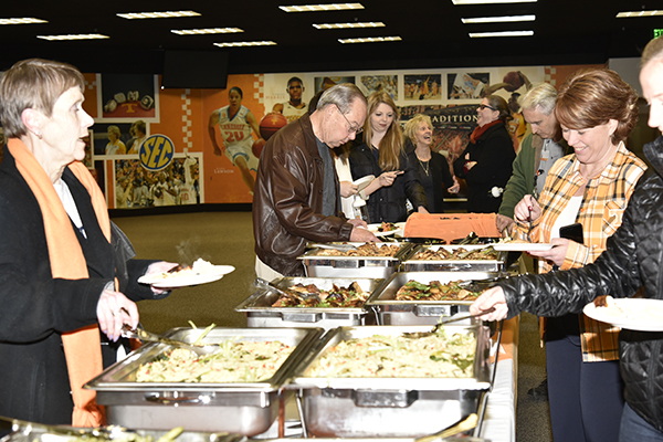 Chancellor Jimmy G. Cheek hosted UT Knoxville employees for a lunch celebrating the launch of the new employee wellness program, Be Well, on Thursday, January 28, in Thompson-Boling Arena. The Be Well team from the Center for Health Education and Wellness helped employees sign up for the Small Starts app and give away gear to help them start making small healthy changes. After lunch, attendees played basketball on the court or walked laps on the concourse level.