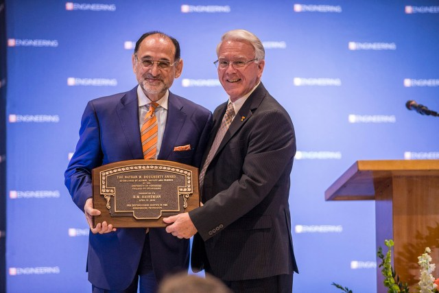 College of Engineering Dean Wayne Davis, right, presents Hash Hashemian with the college's Nathan W. Dougherty Award, it's highest honor.