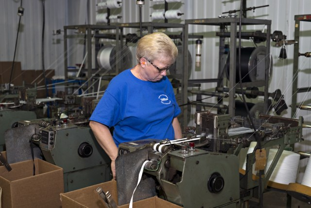 A worker at Dunlap Industries inspects a production line.