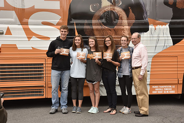 Chancellor Cheek invited the newly admitted Volunteers from Dobyns-Bennett High School to take a picture in front of the Big Orange Bus. From left to right are Brandon Gilliam, Parker Wilkins, Alison Kilgore, Avery Aulds, Maci Snodgrass, and Chancellor Jimmy G. Cheek.