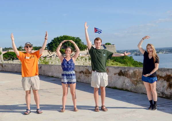 From left to right, freshmen Noah Wessel, Madison Blackburn, Ben Snavely, and Mary Grace Dolan make a VOLS sign with their hands in Havana, Cuba.