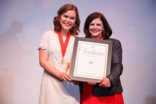 Elisabeth Logan receiving the 2017 Torchbearer Award from Chancellor Davenport.