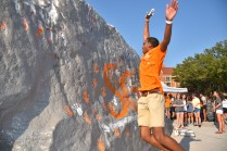 A student jumps in the air during SGA's Slap the Rock on Tuesday, August 22.