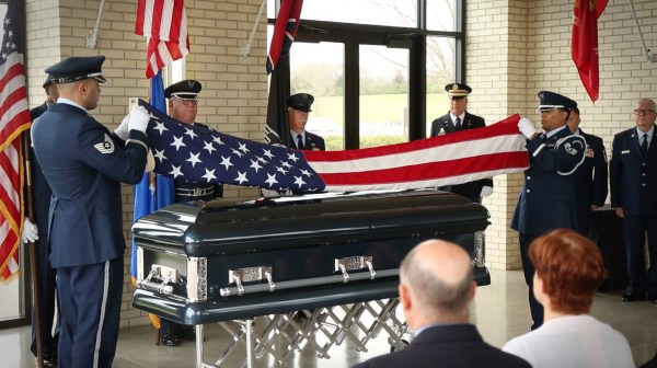 Robinson pays his respects at the funeral of a veteran he has never met.