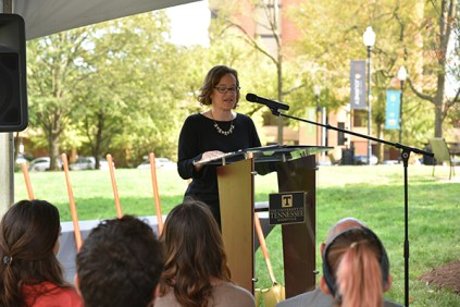 Associate Vice Chancellor for Human Resources Mary Lucal opens a ceremony to honor Chancellor Beverly Davenport on Wednesday in Circle Park.