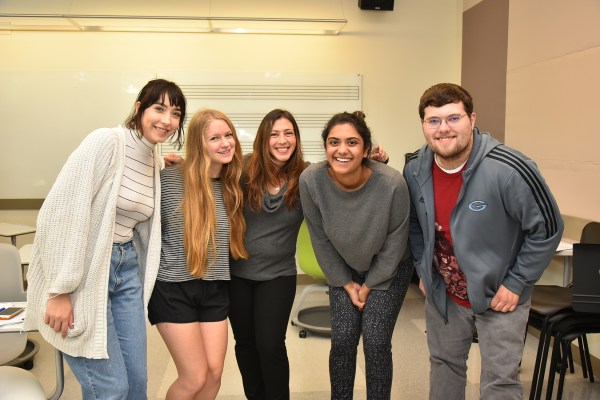 Harper, center, with Avanti Ragnekar, on her right, with other PHIL 256 Social Justice students.