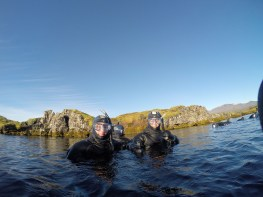 Sydney Bittinger and Lauren Taylor snorkeling in the Silfra Fissure in Thingvellir National Park.