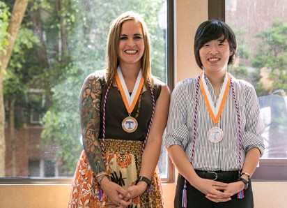 Soon-to-be UT graduates, who are also female military service veterans, received medallions, cords and quilts from the Quilts of Valor group on Tuesday, May 8, 2018. Photo by Erik Campos