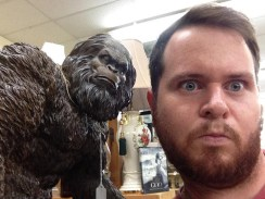 Showing his adventurous spirit, Guthrie takes a selfie with a statue of Sasquatch.