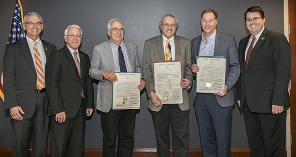 From left to right, University of Tennessee Interim Provost and Senior Vice Chancellor, Dr. John Zomchick and Interim Chancellor Dr. Wayne Davis, second from left, joined TN. state Rep. Eddie Smith, far right, in honoring three UT professors with a resolution stating they are among the top cited researchers in the world. The three professors in the center, holding copies of the resolution are, from left to right, Dr. David Simberloff, Gore Hunger Professor of Environmental Science; Dr. Louis Gross, Director of The Institute for Environmental Modeling and 2018 SEC Faculty Achievement Award winner; and Dr. David Mandrus, Jerry and Kay Henry Endowed Professor in Materials Science and Engineering. Photographed on Friday, May 18, 2018 at the University of Tennessee campus in Knoxville. ..Photo by Erik Campos