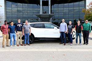 UT's 2018-19 EcoCAR team stands with the car they will be modifying for this year's competition, a Chevy Blazer.