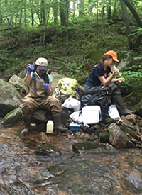 Students of UT-ORNL Governor's Chair for Environmental Biotechnology Terry Hazen take water samples in Pennsylvania.