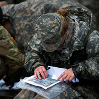 ROTC Cadet Katelyn Wilson, a sophomore at UT Knoxville, works on a navigation exercise.