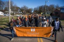 UT students, faculty, and staff sing Rocky Top while joining the Knoxville community for the annual Martin Luther King Jr. Day parade on January 18, 2018. Photo by Steven Bridges