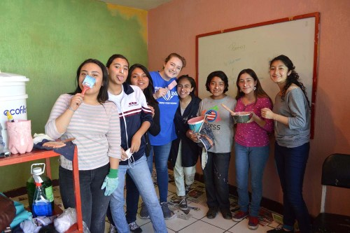 Savannah Dixon and her students paint classroom
