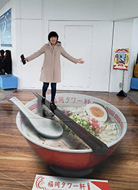 Yuki Minami with a display in the Fukuoka Tower