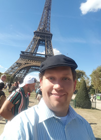 Oliver Trigony in front of the Eiffel Tower