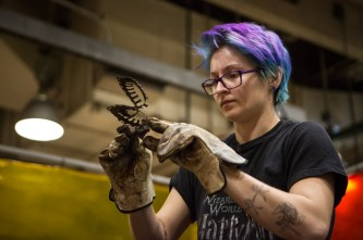 "Students in John Powers' Intermediate and Advanced Sculpture class use scrap metal to create sculptures for the sixth annual ""The Art of Recycling,"" exhibition, which runs through April 21 at the Knoxville Convention Center."