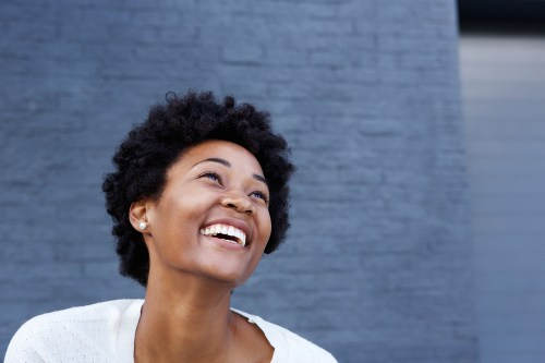 Smiling young african woman looking at copy space