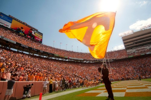 Davy Crockett waving the orange Power T flag at home football game