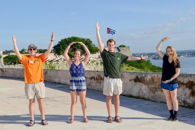 From left to right, UT students Noah Wessel, Madison Blackburn, Ben Snavely, and Mary Grace Dolan make a VOLS sign with their hands in Havana, Cuba.