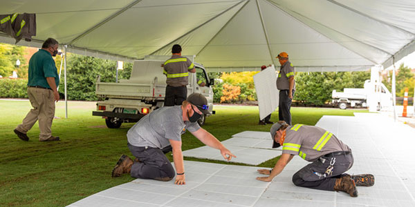 Facilities Services installs an outdoor study space at the Humanities Amphitheater.