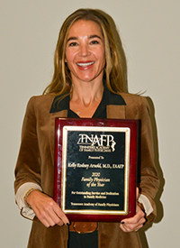 Image of Kelly Arnold holding award