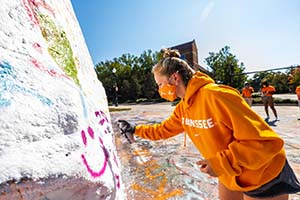 Student paints the Rock as part of Vol Success Week with Division of Student Success
