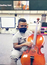 a Knox County student takes a virtual cello lesson