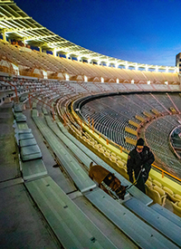 Corporal Mary Cameron and K9 Tica perform a game day walk through of the stands inside Neyland Stadium at sunrise