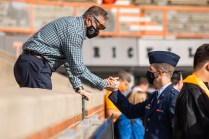 Cadet embraces his father in Neyland Stadium.