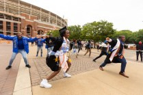 Graduates perform outside Gate 21 at Neyland Stadium after commencement.