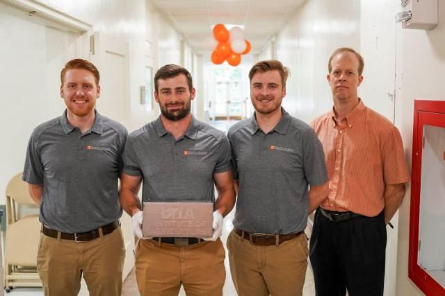 From left are Greg Corson, Ross Zameroski, and Josh Penney with associate professor Bradley Jared.