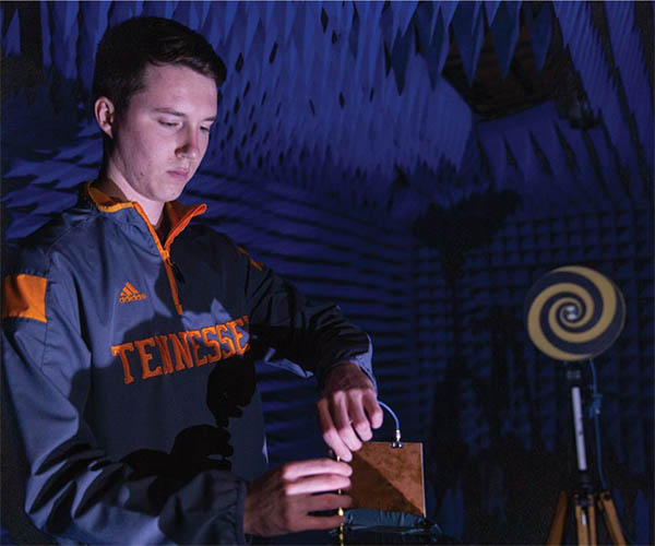 UT graduate student Chandler Bauder examining a wideband antenna for testing in an anechoic chamber that will be used extensively in the proposed 5G antennas evaluation.