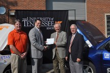 """Dennis Hopkins, Vice President of DENSO Manufacturing Tennessee, Inc. (second from right), presents the check for $50,000 to Dr. Matthew Mench (second from left) as MABE Research Assistant Professor David """"Butch"""" Irick (left) and COE Dean Wayne T. Davis (right) join in expressing appreciation to the company."""