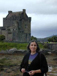 Palmira Brummett in front of Eileen Donan Castle