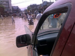 Flooding along the road leading from Tauseef Mutwahir's village | Image courtesy of Tauseef Mutwahir