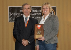 Engin Serpersu, director of the Tennessee Junior Science and Humanities Symposium, presents the 2012 Teacher Mentor Award to Debbie Sayers, teacher at Hardin Valley Academy.