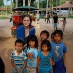 Danielle Gerhard with children in Cambodia