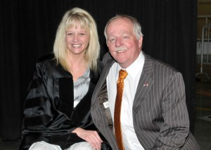 Elisa Luna, principal at Knoxville's Inskip Elementary School, poses with her father, former Tennessee State Sen. Jerry Cooper, prior to the doctoral hooding at the University of Tennessee, Knoxville, on May 12. Luna was paralyzed after she was shot by a disgruntled teacher at Inskip in February 2010.