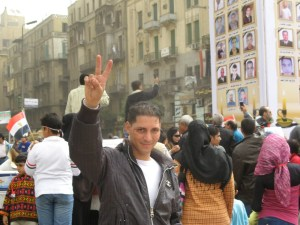 Young protestor flashes peace sign