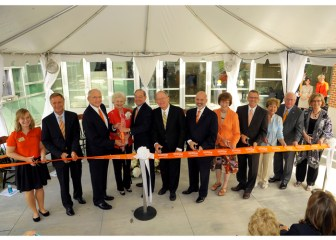 Joining in the ribbon cutting at today's dedication were, from left to right: student Megan Brooker, Gov. Bill Haslam, Jim Haslam, Natalie Haslam, Jimmy G. Cheek, Sen. Lamar Alexaner, Joe DiPietro, Theresa Lee, Jeff Pappas, Sandra Powell, Jim Powell and Margie Stephens.