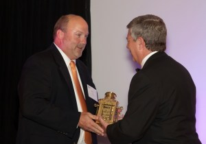 "Bill Hardman, right, president and CEO of the Southeast Tourism Society, presents Steve Morse the Southeast Tourism Society's ""Chairman of the Board"" Shining Example Award"