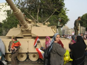 Protesters standing near a tank