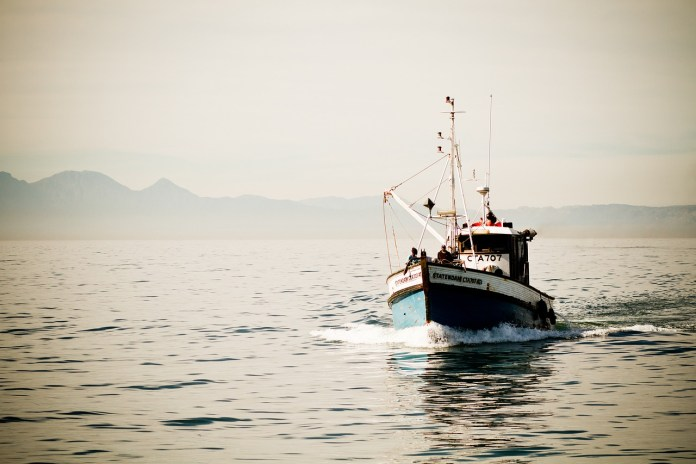 Fishing vessel in Gordon's Bay harbour catches alight